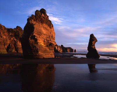 Tongaporutu Coastline - two of the Four Brothers at dusk, 13 August 2003