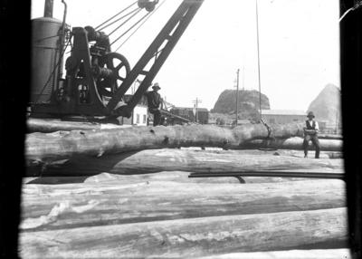 """""""Timber stockpiled on land near root of Main Breakwater. Steam crane in the background."""""""