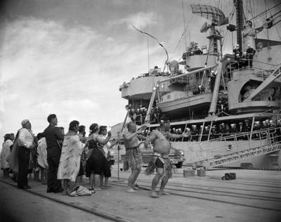 Group of Maori performing a powhiri for the USS Staten Island