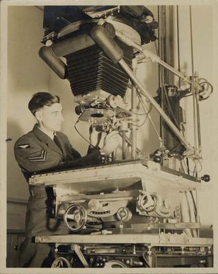Captain Henry Hope-Cross operating Kindermann Cold Light Enlarger, C.P.S Air Force Photographic Unit